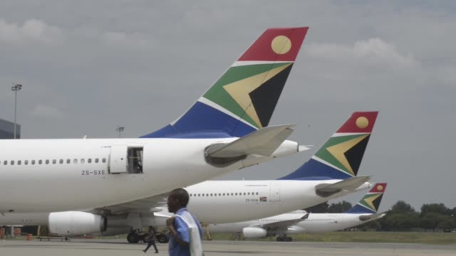 the logo of south african airways sits on the tailfin of airbus group nv a340, left, and a330-200 aircraft parked at or tambo international airport... - thorax stock videos & royalty-free footage