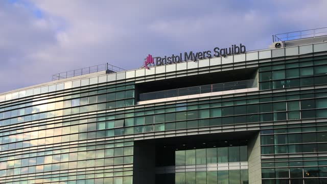 the logo of us pharmaceutical company bristol myers squibb sits on an office building on january 8 in reuil malmaison, france. - politics illustration stock videos & royalty-free footage