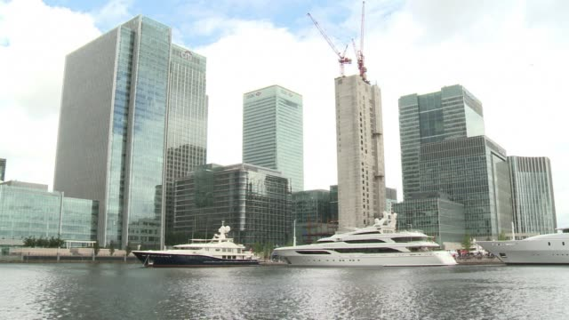 the london business district of canary wharf, a few kilometers to the south of the olympic park, is currently a temporary home to a fleet of... - temporary stock videos & royalty-free footage