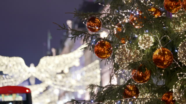 the london christmas lights and christmas tree on lower regents street - christmas decoration stock videos & royalty-free footage