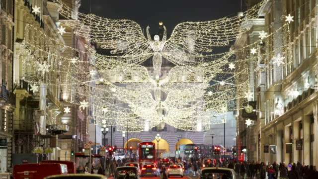 the london christmas lights on a busy festive evening - christmas decoration stock videos & royalty-free footage