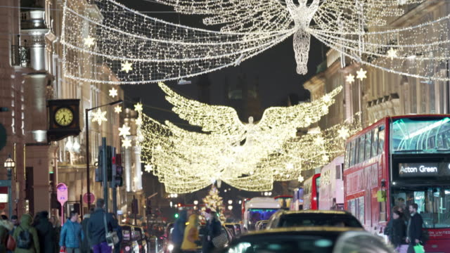 the london christmas lights on a busy festive night - christmas decoration stock videos & royalty-free footage