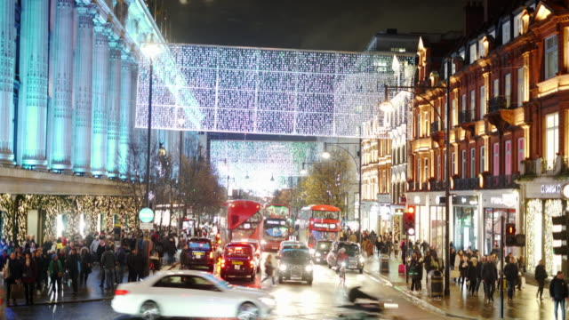 the london christmas lights on a busy oxford street. - christmas decoration stock videos & royalty-free footage