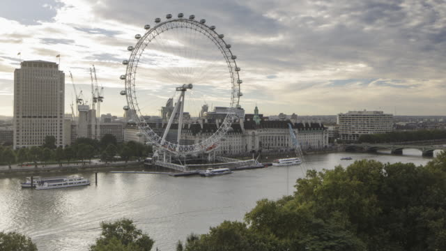 the london eye and river thames, london, uk. - millennium wheel stock videos & royalty-free footage