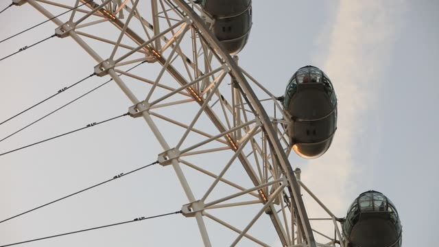 the london eye on the thames south bank, london, uk. - wheel stock videos & royalty-free footage