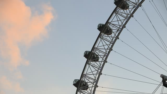 the london eye on the thames south bank london uk - big wheel stock videos & royalty-free footage