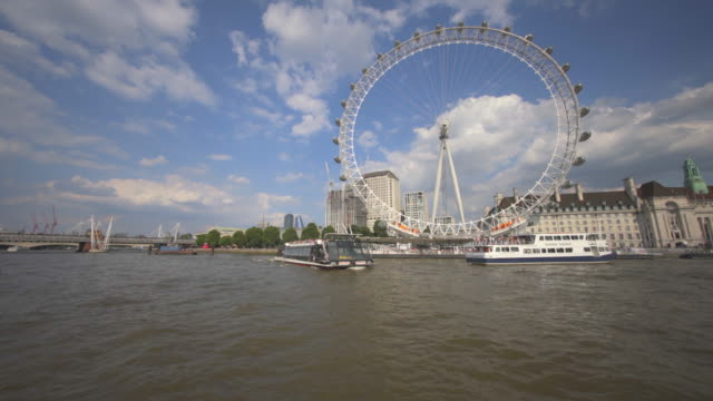 the london eye, or millennium wheel, london, uk - river thames stock videos & royalty-free footage