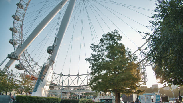 the london eye, or the millennium wheel. tourist observation wheel. trees. - wheel stock videos & royalty-free footage