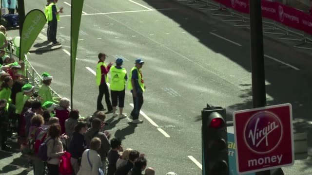 the london marathon got under way on sunday after marking a 30 second period of silence to remember the victims of the boston marathon attacks. clean... - sports period stock videos & royalty-free footage