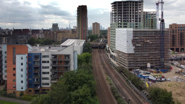 the london skyline at bow creek part of the river lea with the mainline into london fenchurch street and district line - bridge built structure stock videos & royalty-free footage
