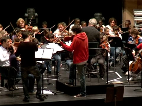 the london symphony orchestra and conductor john eliot gardiner are taking their 'take a bow' concept across the channel coaching young musicians... - london symphony orchestra stock videos & royalty-free footage