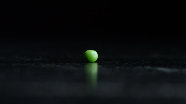 the lone green pea - single object stock videos & royalty-free footage