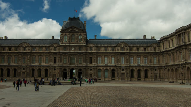 t/l zo the louvre in paris, france with clouds - louvre stock videos and b-roll footage