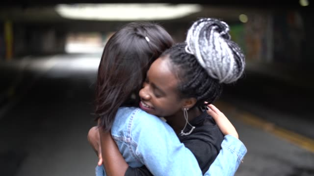 the love of best friends - girlfriends embracing - embracing stock videos & royalty-free footage
