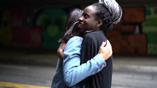 the love of best friends - girlfriends embracing - mixed race person stock videos & royalty-free footage