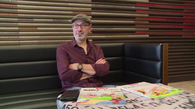 stockvideo's en b-roll-footage met the loveable gaul asterix is set for a new adventure this time in italy explains script writer jean yves ferri during a book faire in buenos aires in... - cartoonist