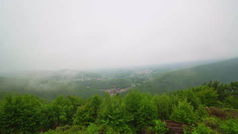 the low clouds and rain in the pocono mountains over jim thorpe town, pennsylvania, carbon county. timelapse accelerated video. - appalachia stock videos & royalty-free footage