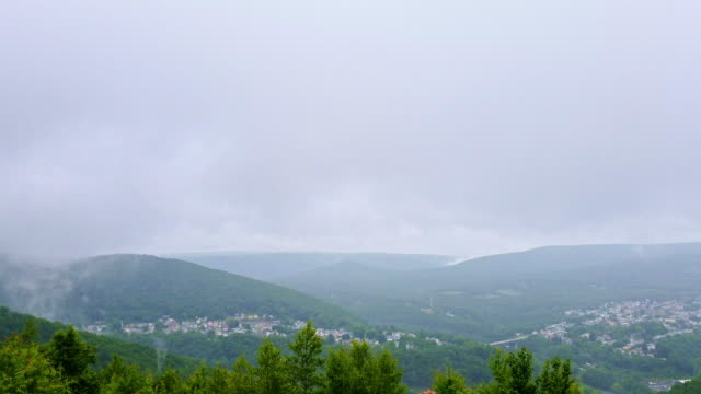 the low clouds and rain in the pocono mountains over jim thorpe town, pennsylvania, carbon county. timelapse-style accelerated mobile video. - appalachian mountains stock videos & royalty-free footage