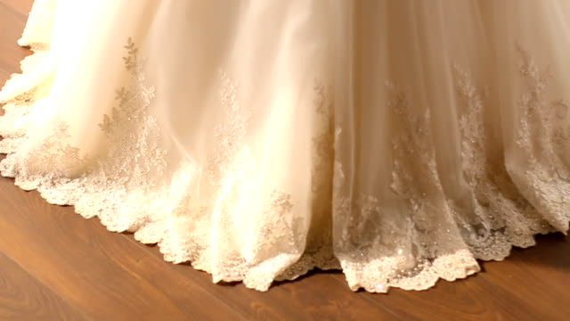 the lower part of a white wedding dress - wedding dress stock videos and b-roll footage