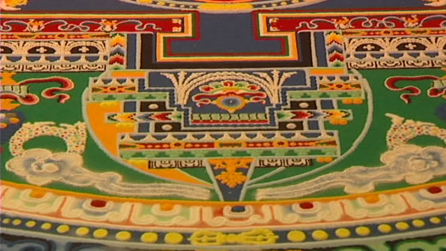 of the lower portion of an ornate mandala, showing its intricate carving and symmetry. - mandala stock videos & royalty-free footage