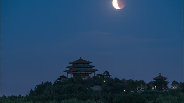 the lunar eclipse is observed over the wan chun ting on may 26, 2021 in beijing, china. - moon stock videos & royalty-free footage