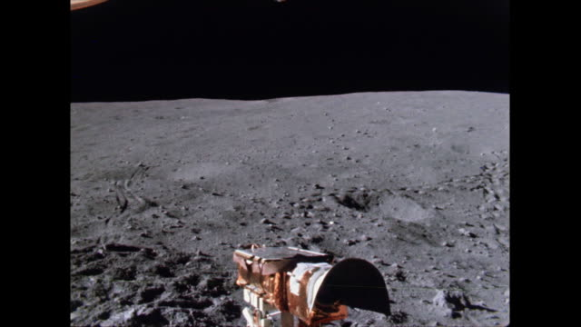the lunar roving vehicle being driven on apollo 16 spacewalk at the descartes landing site. filmed by charlie duke. digitally remastered. - spacewalk stock videos & royalty-free footage