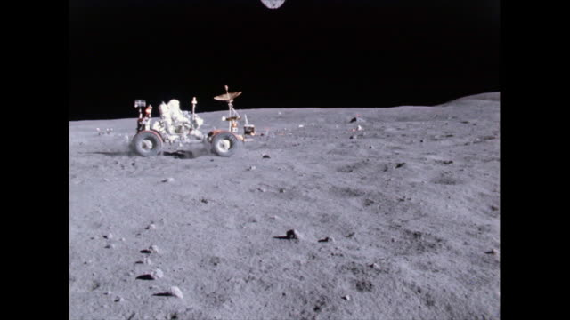the lunar roving vehicle gets a speed workout by astronaut john w young in the grand prix run during the first apollo 16 spacewalk at the descartes... - 1972 stock videos and b-roll footage