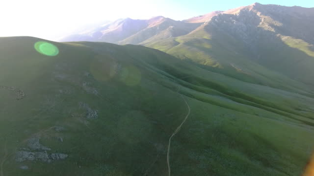 stockvideo's en b-roll-footage met the lush green mountainous planes of javaher dasht, iran. - david ewing