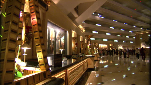 the luxor hotel's tiered ceiling towers over the lobby in las vegas. - lobby stock videos & royalty-free footage
