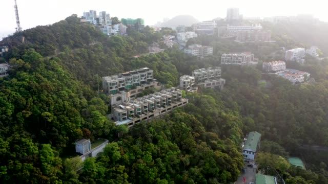 vidéos et rushes de la maison de luxe au sommet de hong kong - victoria peak