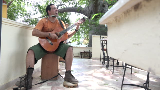 vídeos de stock, filmes e b-roll de the lyrics or verse in the song are a funny parody depicting the new emerging cuban culture after the economic changes of raul castro - sátira