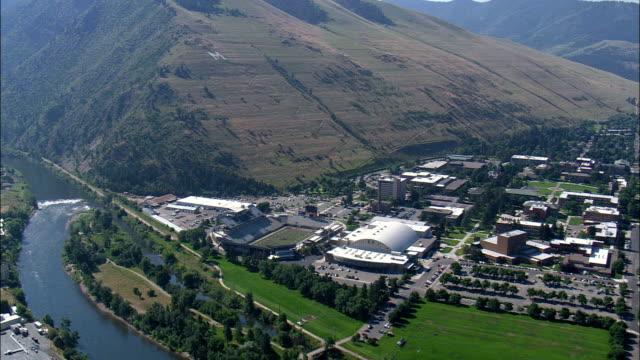 stockvideo's en b-roll-footage met de 'm ' op de heuvel boven missoula - luchtfoto - montana, gezien onder missoula county, verenigde staten - montana westelijke verenigde staten