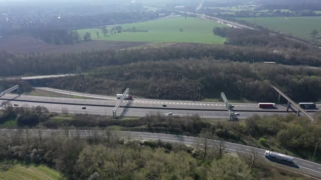 vídeos de stock e filmes b-roll de the m25/m1 motorway junction near st albans in hertfordshire, which joins two of britan's busiest motorways, shows less traffic than normal ahead of... - road junction