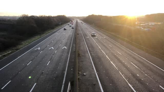 the m4 motorway looking east at rush hour 0842am. taken from bridge between j18-19 close to bristol on the first day of the third national lockdown... - motorway stock videos & royalty-free footage