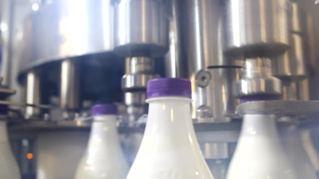 the machine is packing plastic bottles with milk - milk bottle stock videos & royalty-free footage