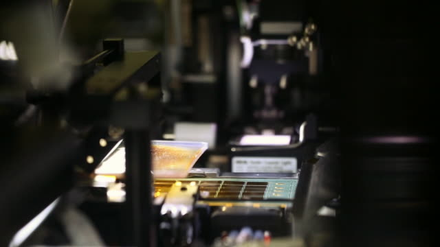 the machine work at semiconductor factory - computer part stock videos and b-roll footage