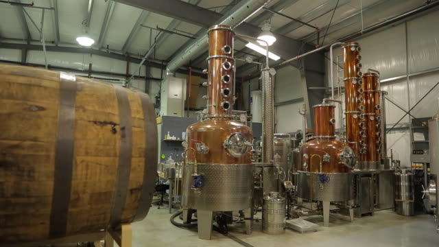 the machines that to distill the alcohol - distillery stock videos and b-roll footage