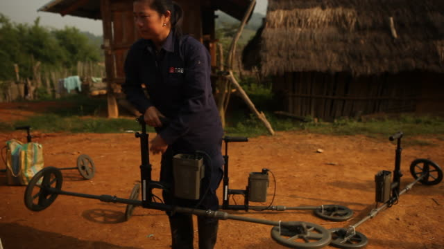 the mag searches for and safely detonates mines and unexploded bombs in laos. - セキュリティスキャナ点の映像素材/bロール