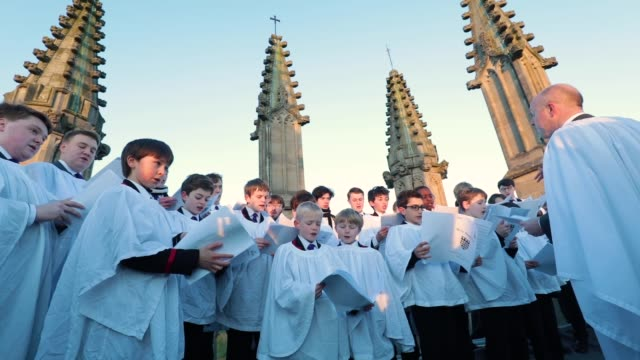 the magdalen college choir sing the hymnus eucharisticus from the top of the great tower, magdalen college at oxford university as the sun rises on... - choir stock videos & royalty-free footage