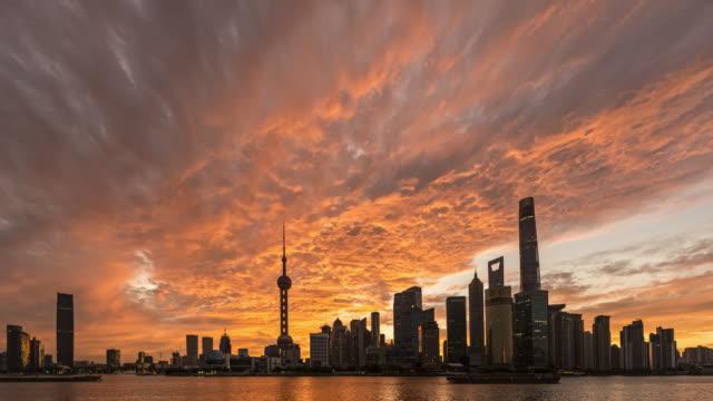 the magnificent sunrise glow over shanghai city - china east asia bildbanksvideor och videomaterial från bakom kulisserna