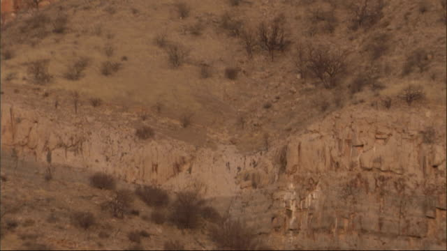 The Maiberg Wall of Namibia rises up to a blue sky. Available in HD.