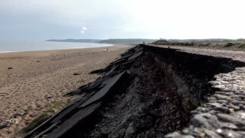 the main coast road at slapton ley in devon was destroyed during storm emma, march 2018. view of a379 road towards the village of torcross / views of... - devon stock videos & royalty-free footage