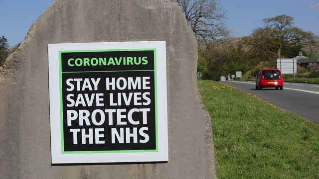 the main entrance to the lake district national park, with the sign telling people to 'stay home, save lives, protect the nhs', in kendal, lake... - shelter in place concept stock videos & royalty-free footage