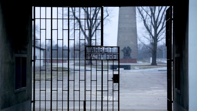 the main gate with the inscription 'work sets you free' at the sachsenhausen concentration camp memorial on january 25, 2019 in oranienburg, germany.... - international holocaust remembrance day stock videos & royalty-free footage
