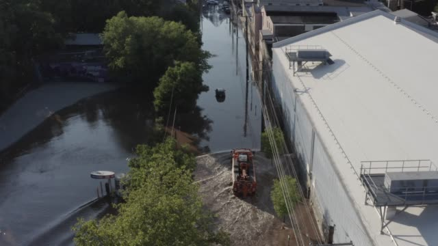 the main street of the philadelphia neighborhood of manayunk is seen flooded following tropical storm isaias which pummelled the region with heavy... - 道路名の標識点の映像素材/bロール