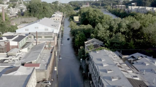 vídeos de stock e filmes b-roll de the main street of the philadelphia neighborhood of manayunk is seen flooded following tropical storm isaias which pummelled the region with heavy... - placa de nome de rua