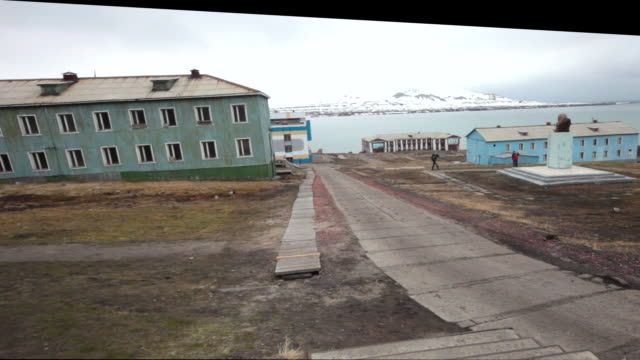 the mains square with the world's second most northernly statue of lenin in barentsburg, a russian mining settlement on svalbard archipelago - 1932 stock videos & royalty-free footage