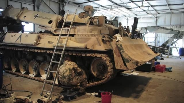 The maintenance of military vehicles is a daily task for Bundeswehr soldiers at Camp Marmal the German troops' base in MazariSharif CLEAN Tanks tuned...