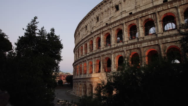 the majestic coliseum of rome in a  summer warm night: vacations in italy - ancient rome stock videos & royalty-free footage