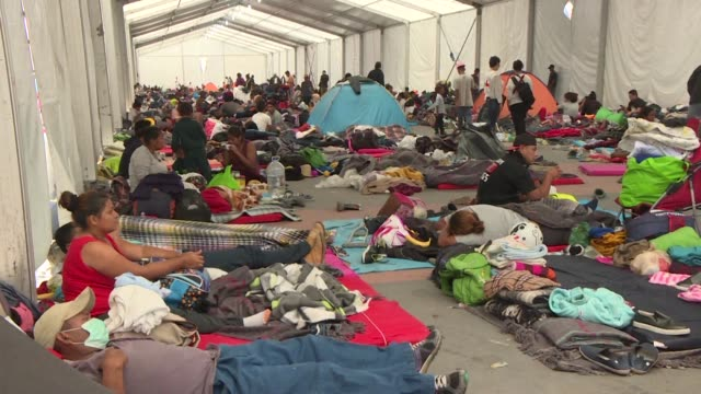 the majority of central american migrants who are a part of a caravan of thousands stay another day at a shelter in mexico city before they are set... - mexican american stock videos & royalty-free footage